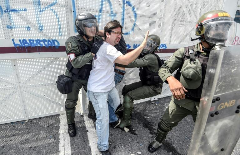 Venezuelan opposition deputy Freddy Guevara is held by members of the Bolivarian National Guard during a protest against the government of President Nicolas Maduro