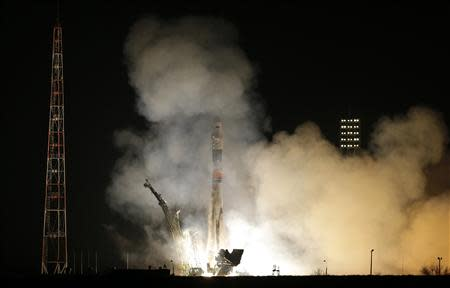 The Soyuz TMA-12M spacecraft carrying the International Space Station (ISS) crew of U.S. astronaut Steven Swanson, Russian cosmonauts Alexander Skvortsov and Oleg Artemyev blasts off from its launch pad at the Baikonur cosmodrome March 26, 2014. REUTERS/Maxim Shemetov