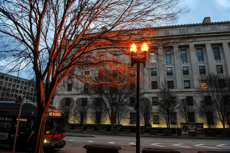 The U.S. Department of Justice building is bathed in morning light at sunrise in Washington