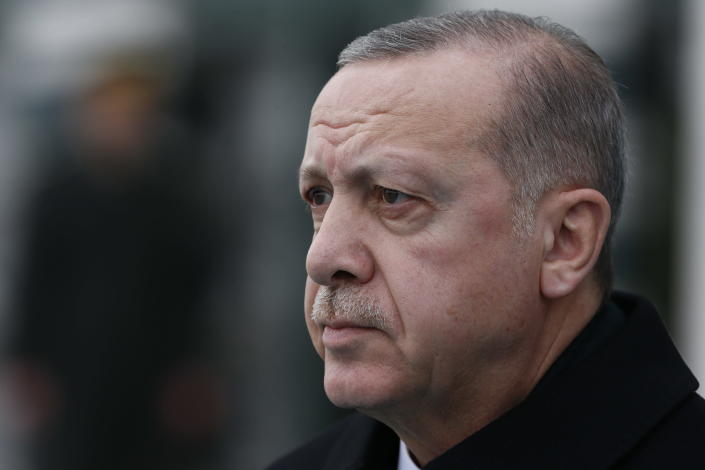 Turkey's President Recep Tayyip Erdogan, stands during the welcome ceremony of Malta's President Marie-Louise Coleiro Preca prior to their meeting at the Presidential Palace in Ankara, Turkey, Thursday Jan. 24, 2019. Erdogan said Turkey opposes coup attempts wherever they may occur.Erdogan, who did not directly reference Venezuela, made the comments at a military academy Thursday hours after he spoke with Venezuela's President Nicolas Maduro.(AP Photo/Burhan Ozbilici)