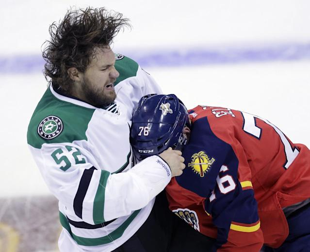 Dallas Stars' Luke Gazdic (52) and Florida Panthers' Eric Selleck (76) fight during the first period of a preseason NHL hockey game, Friday, Sept. 20, 2013, in San Antonio. (AP Photo/Eric Gay)