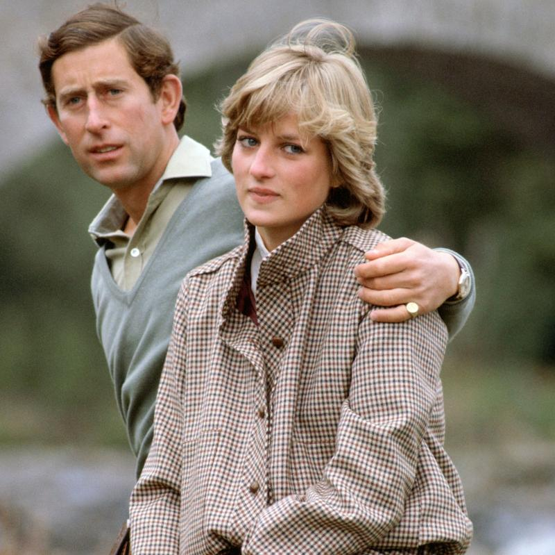 Prince Charles with his arm around Princess Diana - Credit: Getty Images/Getty Images