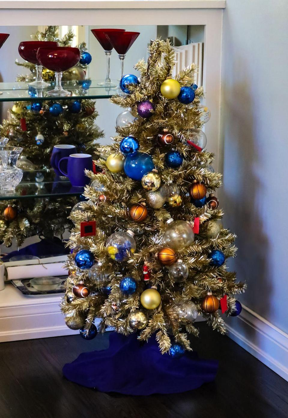 <p>Who says Christmas can't be sporty? This vibrant and festive sports-inspired tree will score big on style while making fans proud.</p>