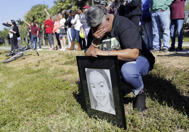 <p>Pat Gibson holds a drawing of Meadow Pollack, a victim of the Marjory Stoneman Douglas High School shooting, as she stands outside of the school as part of a nationwide protest against gun violence, Wednesday, March 14, 2018, in Parkland, Fla. Organizers say nearly 3,000 walkouts are set in the biggest demonstration yet of the student activism that has emerged following the massacre of 17 people at Marjory Stoneman Douglas High School in February. (Photo: Lynne Sladky/AP) </p>