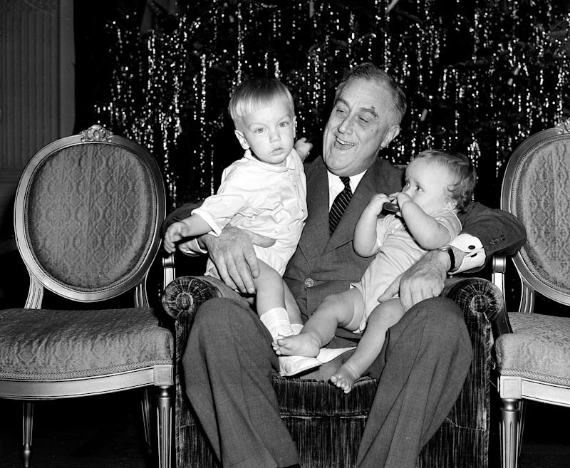FDR with two of his grandchildren on Christmas Day, 1939.