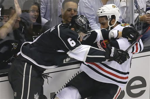 Los Angeles Kings defenseman Jake Muzzin (6) shoves Chicago Blackhawks defenseman Johnny Oduya during the first period of Game 3 of the NHL hockey Stanley Cup playoffs Western Conference finals, Tuesday, June 4, 2013, in Los Angeles. (AP Photo/Jae C. Hong)
