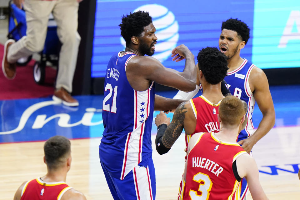Philadelphia 76ers' Joel Embiid (21) reacts after a foul was called against him during the first half of Game 2 in a second-round NBA basketball playoff series against the Atlanta Hawks, Tuesday, June 8, 2021, in Philadelphia. (AP Photo/Matt Slocum)