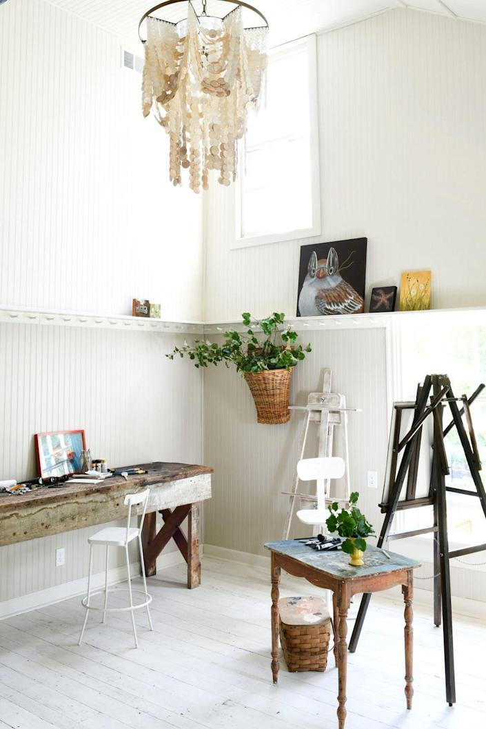 """<p>Use an old bench, side table, or console table like <a href=""""https://leanneford.com/"""" rel=""""nofollow noopener"""" target=""""_blank"""" data-ylk=""""slk:Leanne Ford"""" class=""""link rapid-noclick-resp"""">Leanne Ford</a> did in this artist's retreat. If you choose a reclaimed wood piece or rustic outdoor option, you won't have to be too precious with it, especially if you work with paint and other messy materials as an artist or designer. </p>"""