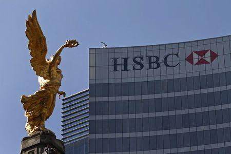 The Angel of Independence monument is seen near a building of HSBC in Mexico City