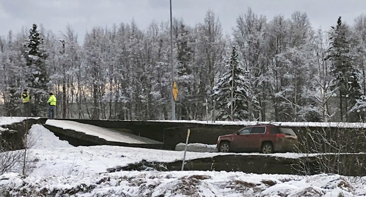 A car is trapped on a collapsed section of a ramp in Anchorage, Alaska, on Friday. (Photo: Dan Joling/AP)