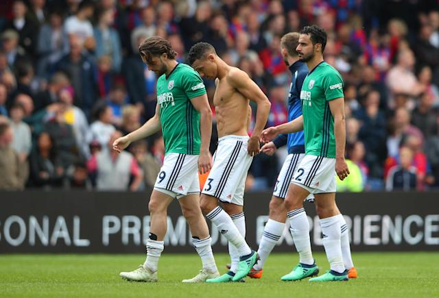 "Soccer Football - Premier League - Crystal Palace vs West Bromwich Albion - Selhurst Park, London, Britain - May 13, 2018 West Bromwich Albion players look dejected after the match REUTERS/Hannah McKay EDITORIAL USE ONLY. No use with unauthorized audio, video, data, fixture lists, club/league logos or ""live"" services. Online in-match use limited to 75 images, no video emulation. No use in betting, games or single club/league/player publications. Please contact your account representative for further details."