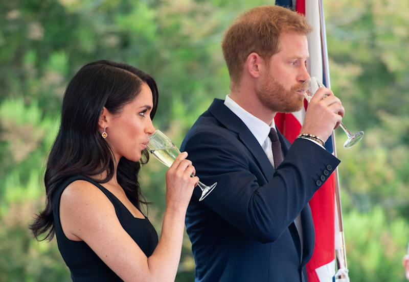 DUBLINE, IRELAND - JULY 10: Prince Harry, Duke of Sussex and Meghan, Duchess of Sussex raise a toast as they attend a Summer Party at the British Ambassador's residence at Glencairn House during their visit to Ireland on July 10, 2018 in Dublin, Ireland. (Photo by Pool/Samir Hussein/WireImage)