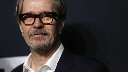 File photo of actor Oldman posing as he arrives for the Saint Laurent fall collection fashion show at the Hollywood Palladium in Los Angeles