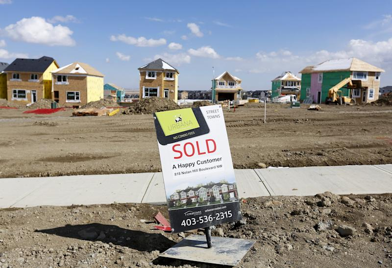 A sold sign is seen at an empty lot in a new sub division in Calgary, Alberta, April 7, 2015. (Reuters)