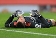 MANCHESTER, ENGLAND - OCTOBER 04: Man Utd goalkeeper David de Gea lies on the ground, exhausted and dejected during the Premier League match between Manchester United and Tottenham Hotspur at Old Trafford on October 4, 2020 in Manchester, United Kingdom. Sporting stadiums around the UK remain under strict restrictions due to the Coronavirus Pandemic as Government social distancing laws prohibit fans inside venues resulting in games being played behind closed doors. (Photo by Simon Stacpoole/Offside/Offside via Getty Images)