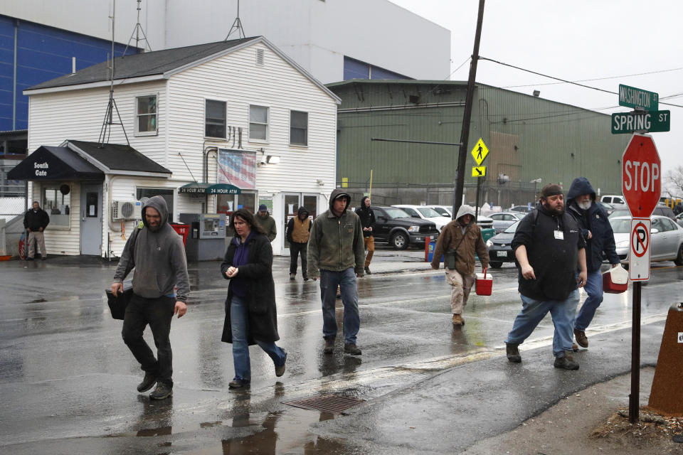 Workers leave Bath Iron Works after a shift, Friday, April 3, 2020, in Bath, Maine. At least two workers at the defense contractor have been diagnosed with the coronavirus. (AP Photo/Robert F. Bukaty)