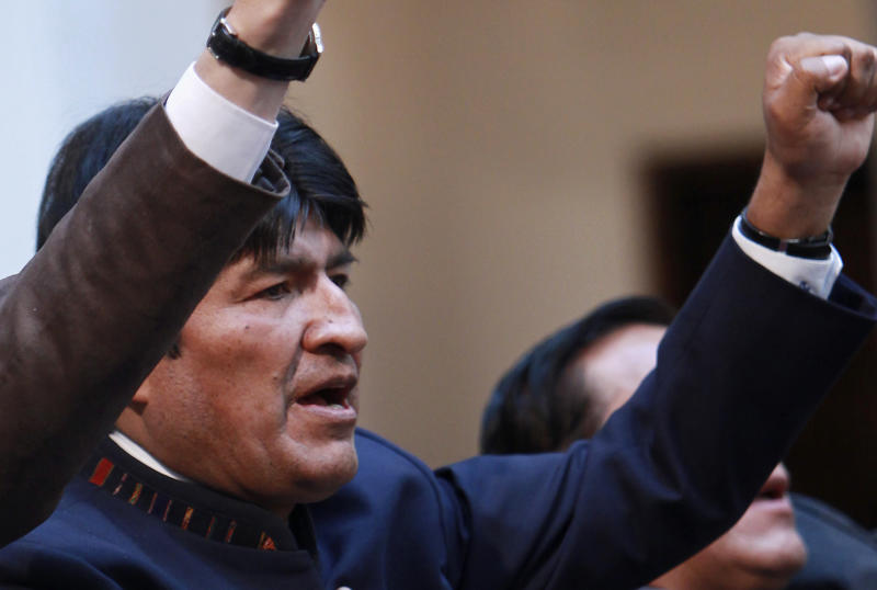 Bolivia's President Evo Morales sings his national anthem during an event at the government palace in La Paz, Bolivia, Tuesday, May 1, 2012.  Morales says his government is completing the nationalization of the country's electricity industry by taking over its electrical grid from a Spanish-owned company. (AP Photo/Juan Karita)