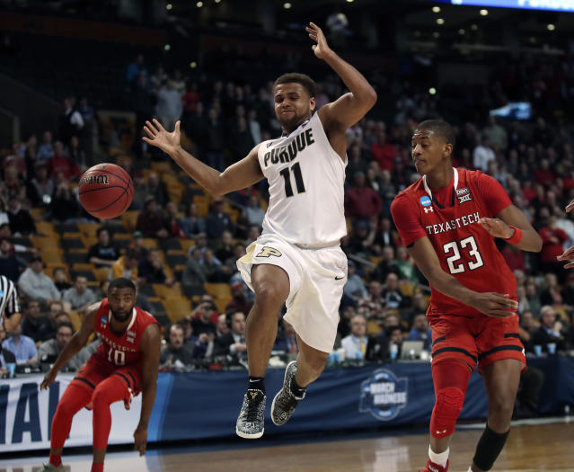 Purdue's P.J. Thompson, middle, loses the ball as he drives against Texas Tech's Jarrett Culver, right, during the second half of an NCAA men's college basketball tournament regional semifinal, earlly Saturday, March 24, 2018, in Boston. (AP Photo/Charles Krupa)