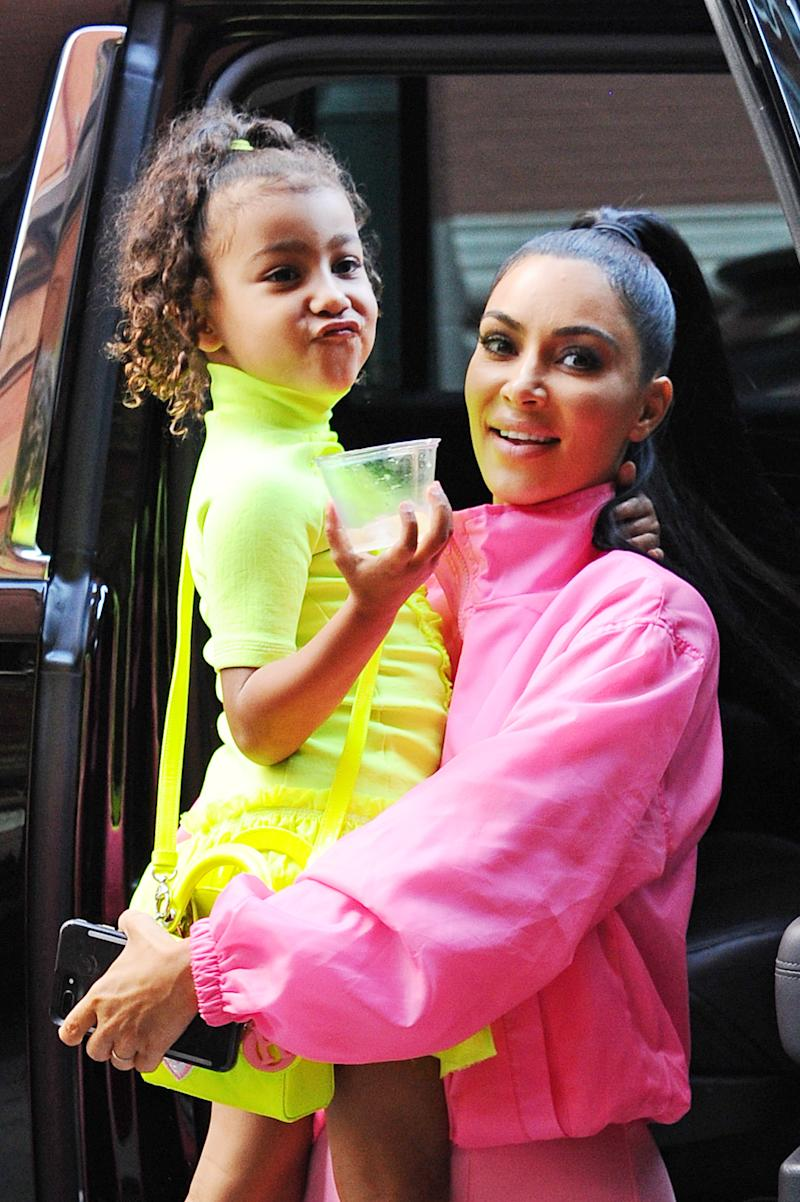 """Kim Kardashian's children are growing up fast, and the reality star posted a throwback photo of daughter North helping with son Psalm. """"How are my babies getting so big,"""" Kardashian wrote. (Photo: Josiah Kamau/BuzzFoto via Getty Images)"""