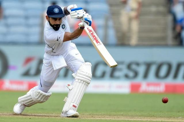 India's captain Virat Kohli plays a shot on the second day of the second Test cricket match between India and South Africa at the Maharashtra Cricket Association Stadium in Pune (AFP Photo/PUNIT PARANJPE)