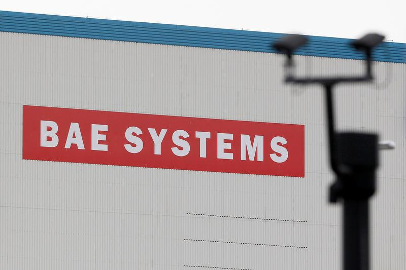 FILE PHOTO - A BAE Systems sign is seen at the entrance to the naval dockyards in Portsmouth