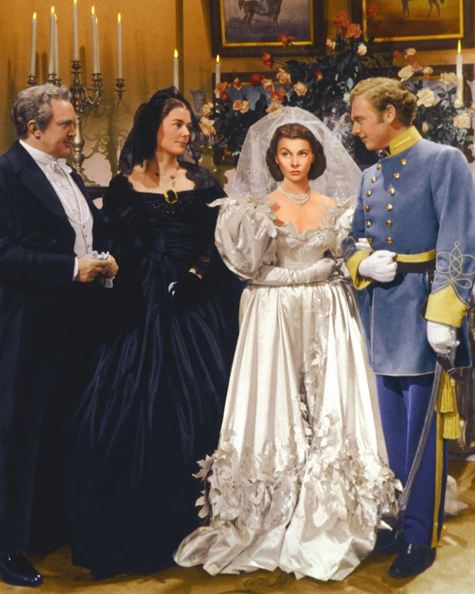 """<p>All hail Scarlett O'Hara as the most understatedly thrifty fashionista of her time. First of all , she says """"I do"""" in her mother's wedding gown. Second of all, this getup was made out of curtains. Iconic.</p>"""