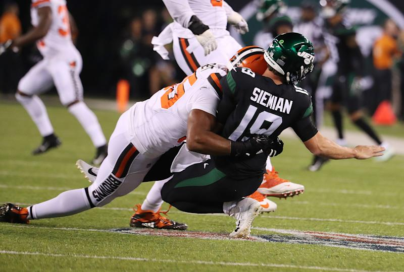 Trevor Siemian of the New York Jets was hurt on this play after he was tackled by Myles Garrett. (Getty Images)