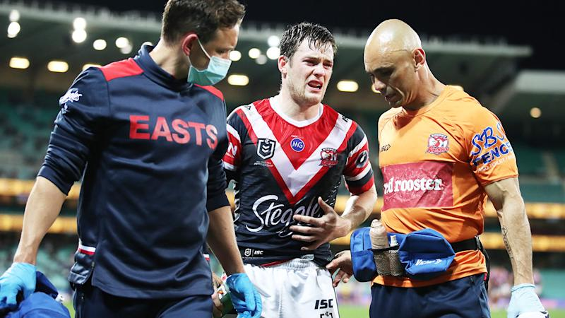 Luke Keary, pictured here being attended to by trainers.