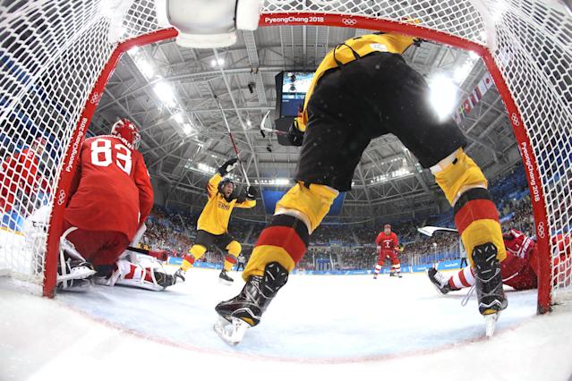 <p>Brooks Macek #12 and Patrick Hager #50 of Germany celebrate after a goal by teammate Felix Schutz #55 (not pictured) in the second period against Vasili Koshechkin #83 of Olympic Athlete from Russia during the Men's Gold Medal Game on day sixteen of the PyeongChang 2018 Winter Olympic Games at Gangneung Hockey Centre on February 25, 2018 in Gangneung, South Korea. (Photo by Bruce Bennett/Getty Images) </p>
