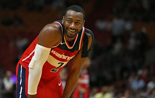 "The <a class=""link rapid-noclick-resp"" href=""/nba/teams/was/"" data-ylk=""slk:Washington Wizards"">Washington Wizards</a>' <a class=""link rapid-noclick-resp"" href=""/nba/players/4716/"" data-ylk=""slk:John Wall"">John Wall</a> smiles during the fourth quarter against the <a class=""link rapid-noclick-resp"" href=""/nba/teams/mia/"" data-ylk=""slk:Miami Heat"">Miami Heat</a> at the AmericanAirlines Arena in Miami on Wednesday, Nov. 15, 2017. The Wizards won, 102-93. (David Santiago/Miami Herald/TNS)"