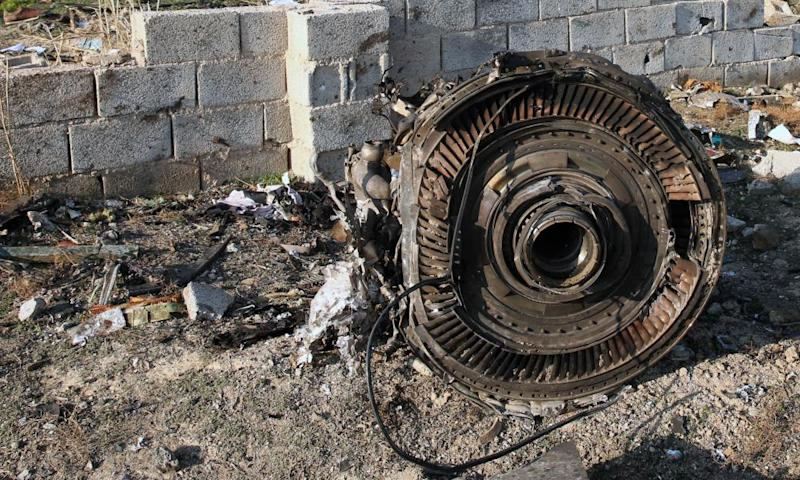 An engine lies on the ground after Wednesday's plane crash.