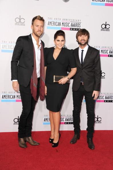 Lady Antebellum arrives on the 2012 American Music Awards red carpet.