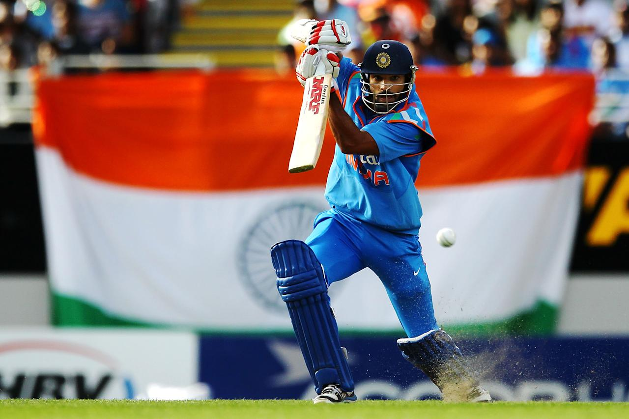AUCKLAND, NEW ZEALAND - JANUARY 25: Shikhar Dhawan of India bats during the One Day International match between New Zealand and India at Eden Park on January 25, 2014 in Auckland, New Zealand.  (Photo by Anthony Au-Yeung/Getty Images)