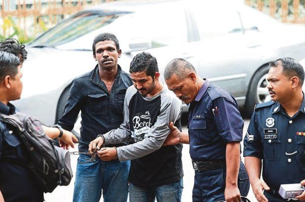 Muhammad Syakir (centre) was charged at the Sessions Court for negligence and careless behaviour which resulted in the death of Muhammad Iqram Danish Abdullah. — Malay Mail pic