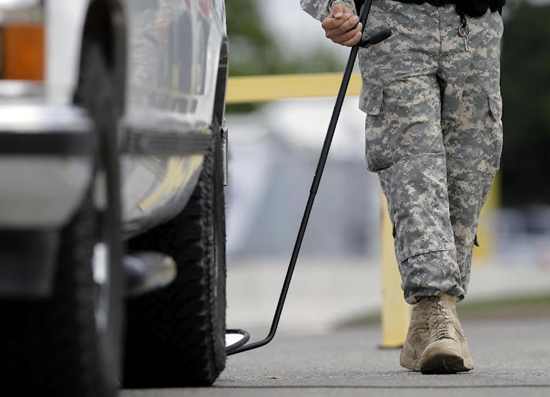 A mirror is used on a vehicle at a checkpoint to enter the Lawrence William Judicial Center as the sentencing phase for Maj. Nidal Hasan begins, Monday, Aug. 26, 2013, in Fort Hood, Texas. Hasan, who was convicted of killing 13 people in the November 2009 attack at Ford Hood, faces the death penalty as the sentencing phase of his trial begins Monday. (AP Photo/Eric Gay)