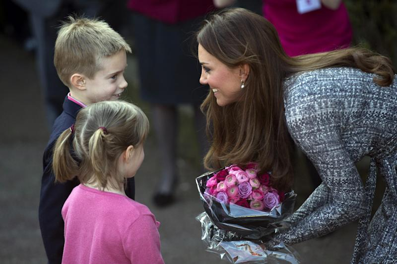 Britain's Kate, The Duchess of Cambridge receives flowers, as she leaves after a visit to Hope House, in London, Tuesday, Feb. 19, 2013. As patron of Action on Addiction, the Duchess was visiting Hope House, a safe, secure place for women to recover from substance dependence. (AP Photo/Matt Dunham)