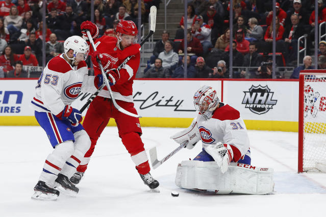 Montreal Canadiens goaltender Carey Price (31) stops a shot as Victor Mete (53) and Detroit Red Wings left wing Justin Abdelkader (8) battle for the rebound in the second period of an NHL hockey game, Tuesday, Feb. 26, 2019, in Detroit. (AP Photo/Paul Sancya)