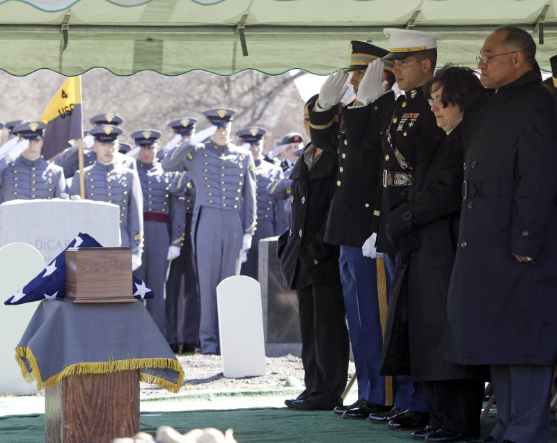 The family of 1st Lt. Daren Hidalgo salute a container with his remains during a graveside service in West Point, N.Y., on Monday, March 7, 2011. Hidalgo, of Waukesha, Wis., and a 2009 graduate of West Point, died Feb. 20 in Kandahar province after insurgents attacked his unit with an improvised explosive device.  From left are sister Carmen Spellman, brothers Army Capt. Miles Hidalgo and Marine Capt. Jared Hidalgo, and parents Andrea and Jorge Hidalgo. (AP Photo/Mike Groll)