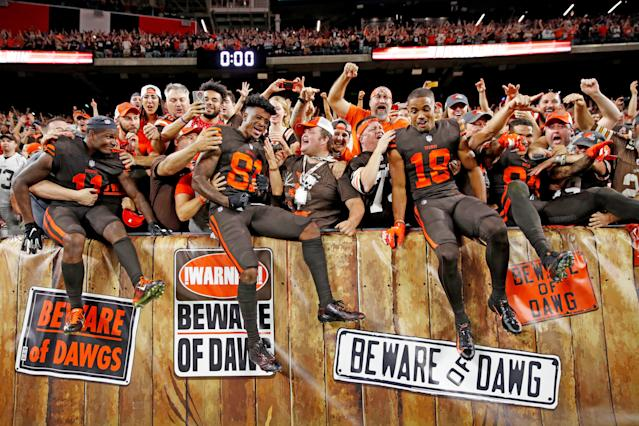 <p>Antonio Callaway #11, Rashard Higgins #81 and Damion Ratley #18 of the Cleveland Browns celebrate with fans by jumping into the seats after the game against the New York Jets at FirstEnergy Stadium on September 20, 2018 in Cleveland, Ohio. The Browns won 21-17. (Photo by Joe Robbins/Getty Images) </p>