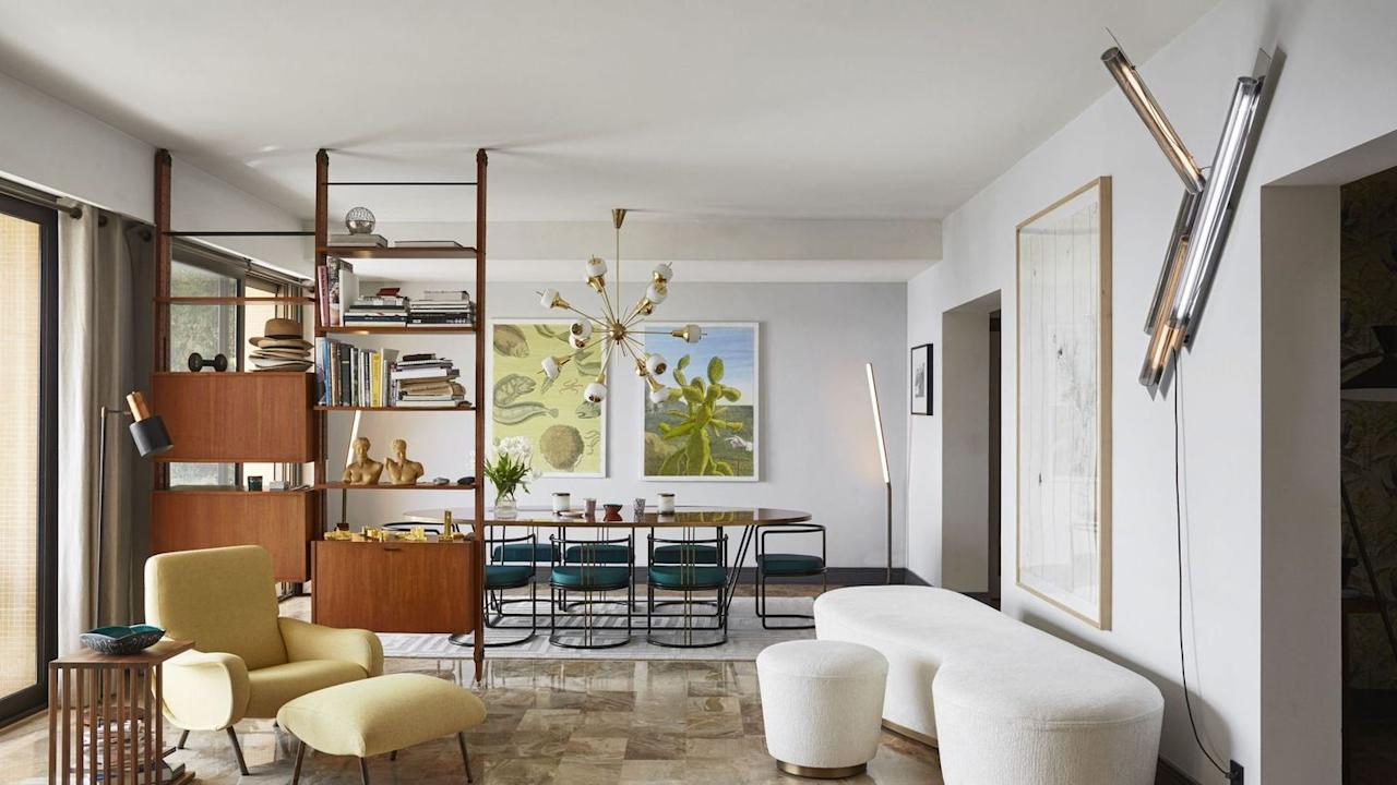 <p>In a glamorous Monte Carlo apartment, pinkish-beige marble tile flooring—original to the 1970s-built building—is accented with chunky-yet-sculptural furniture that tempers the room's vintage bones. </p>