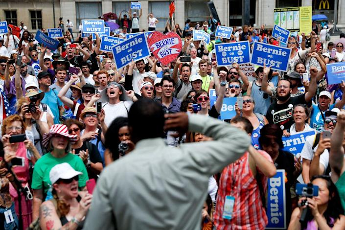<p>Supporters of Sen. Bernie Sanders yell during a rally near City Hall in Philadelphia, Tuesday, July 26, 2016, during the second day of the Democratic National Convention. (Photo: John Minchillo/AP)</p>