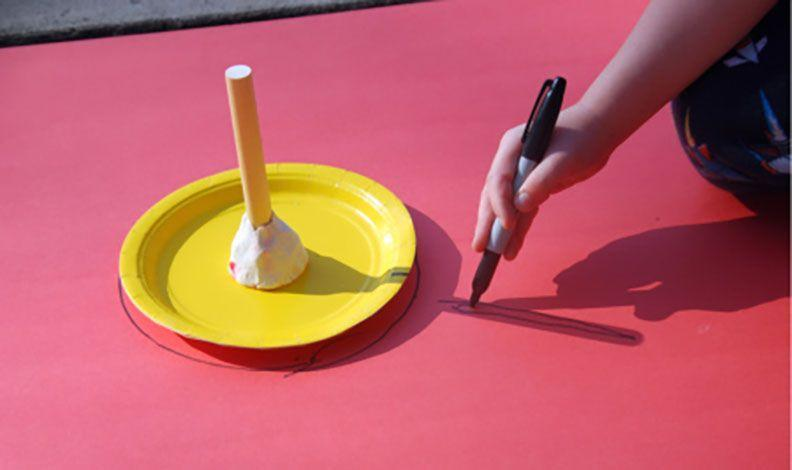 """<p>Making a homemade sundial is one of the lowest-prep science experiments you can do: You just need a dowel or a good stick, a paper plate, and a marker. Mark the position of the dowel's shadow every hour, and you've got an easy opening into talking about the Earth's rotation. The next day, see if your sundial tells accurate time while playing outside.</p><p><em><a href=""""https://happybrownhouse.com/how-to-make-a-sundial-with-children/"""" rel=""""nofollow noopener"""" target=""""_blank"""" data-ylk=""""slk:Get the tutorial at Happy Brown House »"""" class=""""link rapid-noclick-resp"""">Get the tutorial at Happy Brown House »</a></em></p>"""