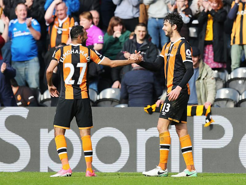 Andrea Ranocchia celebrates scoring his side's second goal with Ahmed Elmohamady: Getty