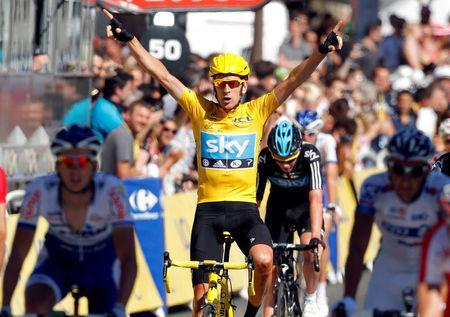 FILE PHOTO: Sky Procycling rider and leader's yellow jersey Bradley Wiggins of Britain celebrates on the finish line after the final 20th stage of the 99th Tour de France cycling race between Rambouillet and Paris, France, July 22, 2012. REUTERS/Gonzalo Fuentes/File Photo
