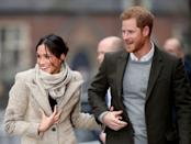 <p>Comfortable and casual, the pair was caught mid-hand grab outside of Reprezent radio station in Brixton. Markle wore her hair up in a messy bun, sporting a stone-colored wool coat by Smythe with a matching loose scarf around her neck. Harry appeared dashing in a moss-green blazer layered over a light grey sweater.</p>