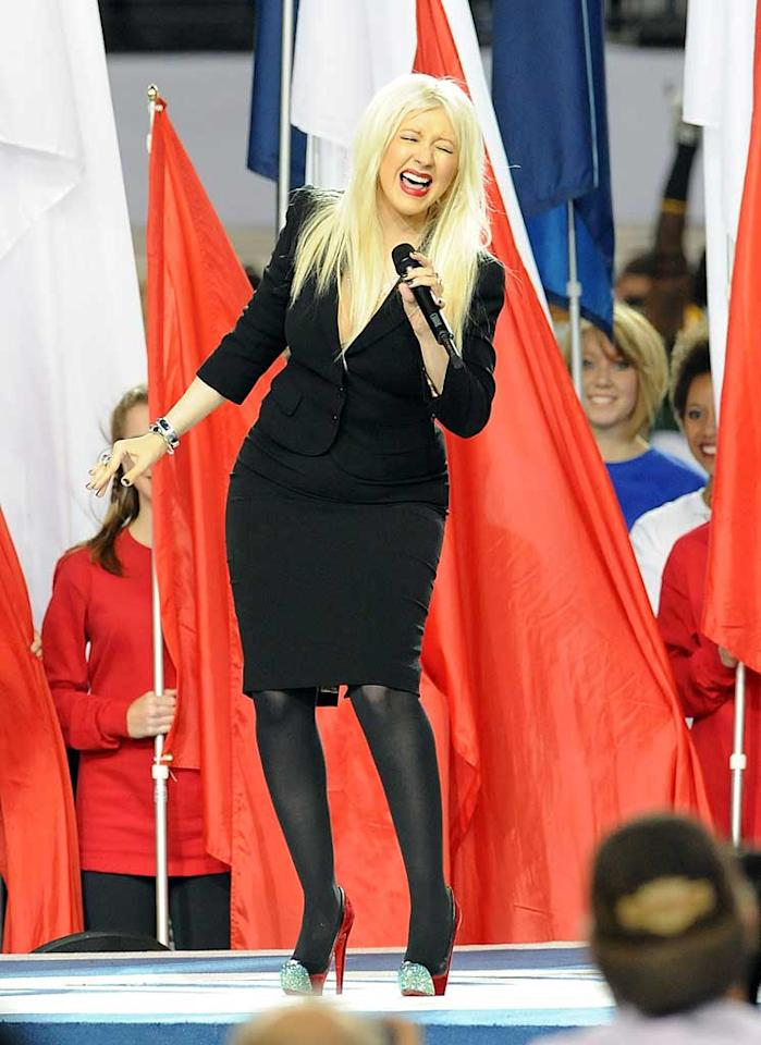 "Next up? Christina Aguilera, who took center stage in a black Dolce & Gabbana suit to perform the National Anthem. Unfortunately, the ""Burlesque"" beauty flubbed the lyrics. Instead of singing, ""O'er the ramparts we watched were so gallantly streaming,"" she said, ""What so proudly we watched at the twilight's last gleaming."" Oops! Later, Aguilera issued a statement explaining her mistake: ""I got so caught up in the moment of the song that I lost my place. I can only hope that everyone could feel my love for this country and that the true spirit of it's anthem still came through."" Jeff Kravitz/<a href=""http://www.filmmagic.com/"" target=""new"">FilmMagic.com</a> - February 6, 2011"