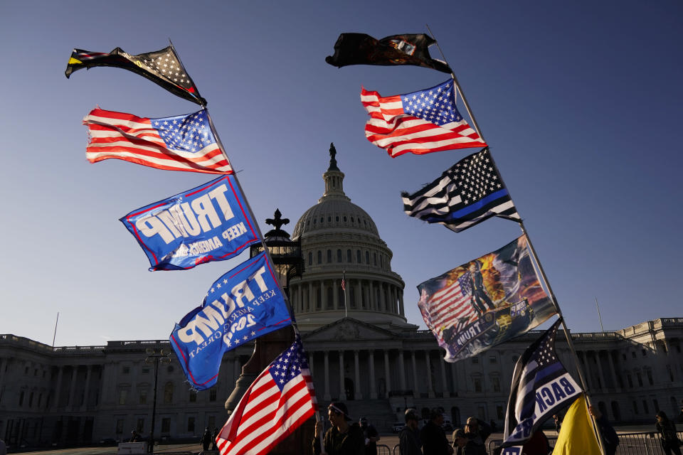With the U.S. Capitol in the background, flags fly as supporters of President Donald Trump attend pro-Trump marches, Saturday Nov. 14, 2020, in Washington. (AP Photo/Jacquelyn Martin)