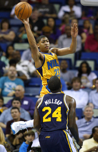 New Orleans Hornets power forward Anthony Davis (23) passes the ball over Utah Jazz power forward Paul Millsap (24) during the first half of an NBA basketball game in New Orleans, Friday, Nov. 2, 2012. (AP Photo/Jonathan Bachman)