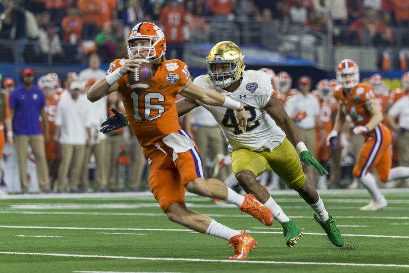 Clemson Tigers QB Trevor Lawrence (16) gets chased by Notre Dame Fighting Irish defensive lineman Julian Okwara (42) during the CFP semifinal last season. (Getty)