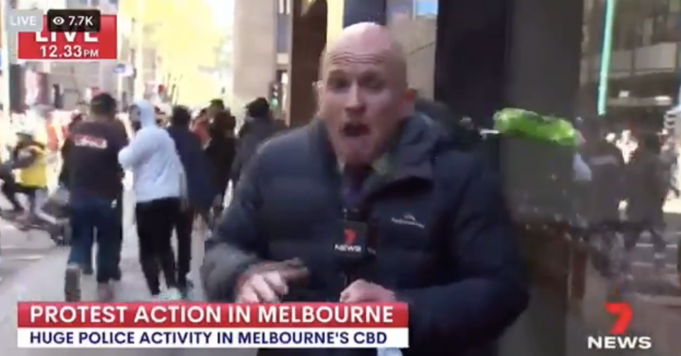 Paul Dowsley faces attacks from protesters in a separate incident while covering a rally against mandatory COVID vaccines in Melbourne, Australia. (7News)